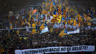 Independence demonstrators wave esteladas or independence flags during a demonstration supporting the imprisoned pro-independence political leaders in Barcelona on Saturday.