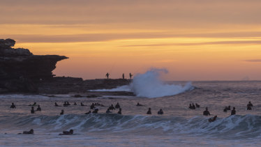 Surfers return to Marboubra beach on Monday.