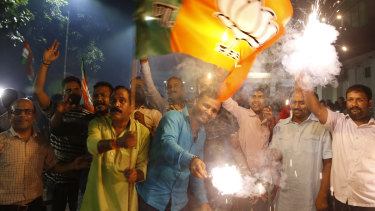 Supporters of India's ruling Bharatiya Janata Party (BJP) light firecrackers and celebrate the government revoking Kashmir's special status in Lucknow, India.