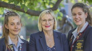 Star of the Sea principal Mary O'Connor with college co-captains Macy O'Sullivan (left) and Julia Fullard.