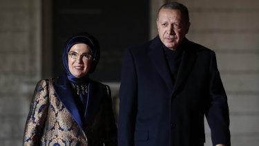 Turkey's President Recep Tayyip Erdogan and his wife Emine Erdogan arrive at an Armistice Day dinner in Paris.
