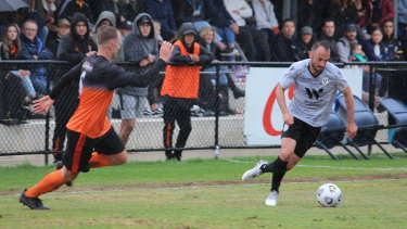 Macarthur FC defender Ivan Franjic takes the ball forward against Camden Tigers in the A-League club's inaugural pre-season outing.