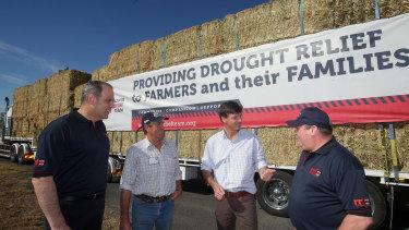 Rapid Relief Team chairman Merrick Grimshaw (left), farmer Tony Biffin, MP Angus Taylor and RRT director Ron Arkcoll.