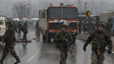 Indian paramilitary soldiers patrol near the site of an explosion in Pampore, Indian-controlled Kashmir.