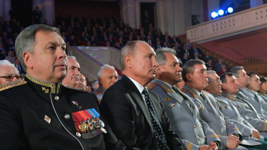 Deputy GRU chief, vice-admiral Igor Kostyukov sits next to Russian President Vladimir Putin in 2018.