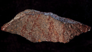 A drawing made with ochre pigment on silcrete stone, found in the Blombos cave east of Cape Town, South Africa.