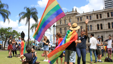 Crowds in Queens Garden, Brisbane, celebrate the Yes vote's same-sex marriage postal survey win in November 2017.