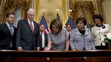 House Speaker Nancy Pelosi signs a deal to reopen the government.