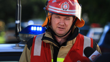 Queensland Fire and Emergency Service Inspector Bevan Moore addresses the media.