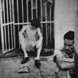 An emaciated prisoner sits against the bars of a cell at the Cabana Fortress in Havana in this photo smuggled out by a former Cuban rebel officer, Lt. Hirm Gonzalez. February 12, 1962.