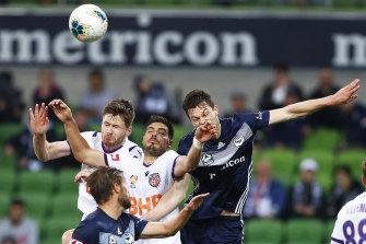 Tough contest: Perth's Bruno Fornaroli, centre, heads the ball against James Donachie.