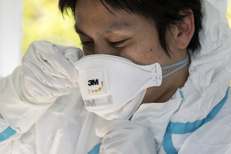 A staff member of the Yokosuka Medical Association wears a N95 mask in a Japan.