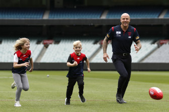 Jones plays with his children at the MCG.