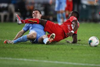 Melbourne City's Curtis Good and United's Pacifique Niyongabire collide.