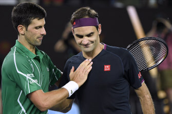 Novak Djokovic with Roger Federer after their semi-final showdown at the Australian Open.