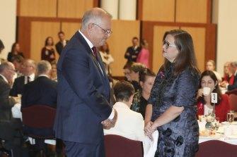 Prime Minister Scott Morrison speaks with Sex Discrimination Commissioner Kate Jenkins.