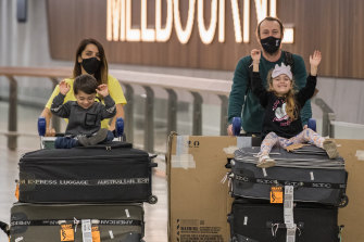 Vicky Yegen and Shayne Ryan arrive at Melbourne Airport on Monday with their children William and Talia.