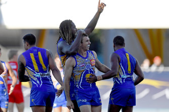Jamie Cripps and Nic Naitanui celebrate a goal in the Eagles' win over Sydney.