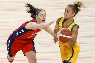 Leilani Mitchell of the Opals passes against Sue Bird.