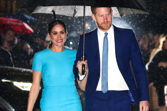 A beaming Meghan and Harry arrive at the Endeavour Fund Awards.