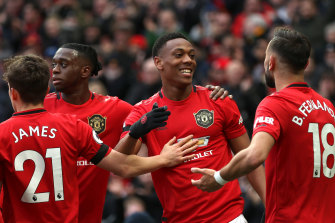Anthony Martial celebrates with his Manchester United teammates after scoring his team's second goal against Watford at Old Trafford on Sunday.
