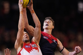 Jake Lever (right) competing for the ball with Sam Reid of the Swans on Friday night.