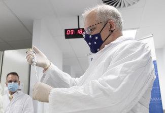 On the COVID case ... Prime Minister Scott Morrison takes a lab tour.