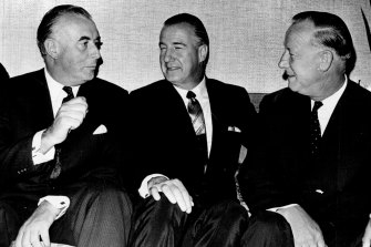 The Leader of the Federal Opposition, Mr. E. G. Whitlam (left), and the Deputy Leader, Mr. L. H. Barnard, (right) talk with the U.S. Vice-President, Mr. Spiro Agnew, at the Canberra Rex Hotel yesterday. January 16, 1970.