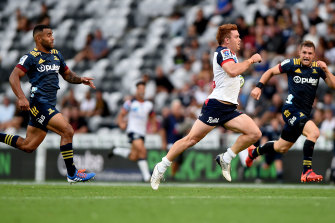 Andrew Kellaway races away to score one of his two tries for the Rebels against the Highlanders.