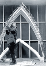 Joe Bertony at work on a model of the erection arch in 1963.