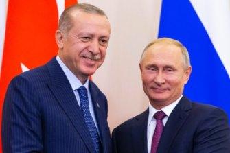 Russian President Vladimir Putin, right, and Turkish President Recep Tayyip Erdogan shake hands in September.