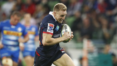 Reece Hodge runs a try in for the Rebels against the Stormers at AAMI Park in Melbourne on Friday night.