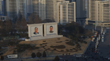 Portraits of late North Korean leaders Kim Il-Sung and Kim Jong-il in Pyongyang.