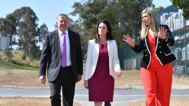 Corinne Mulholland, right, on the campaign trail with Anthony Albanese and Labor's Dickson candidate, Ali France.