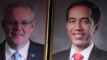 Concluding a trade deal: posters of Australian Prime Minister Scott Morrison (left) and Indonesian President Joko Widodo.