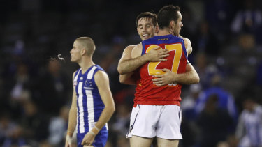 The Lions celebrate after the siren.
