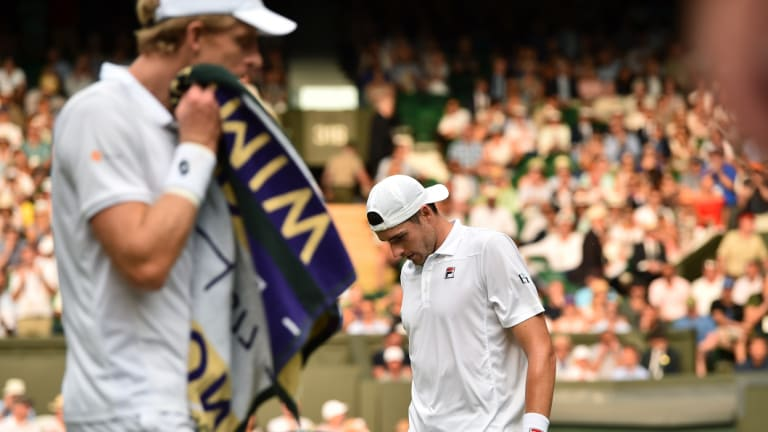 Kevin Anderson, left, and John Isner change ends during their semi-final match at Wimbledon this year.