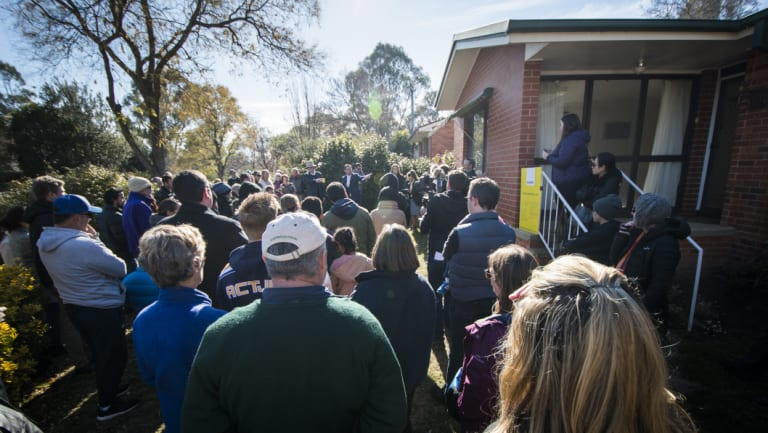 Hundreds of people attended the auction of the Watson home, which sold for $761,000.