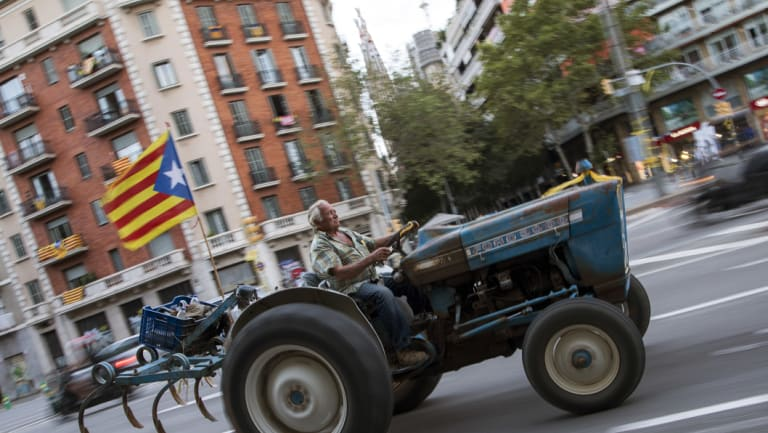 A man drives a tractor decorated with a pro-Independence flag during the Catalan National Day on Tuesday.
