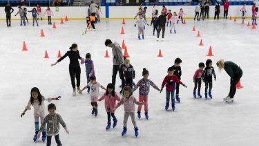 Children skating at Macquarie Ice Rink on Thursday.