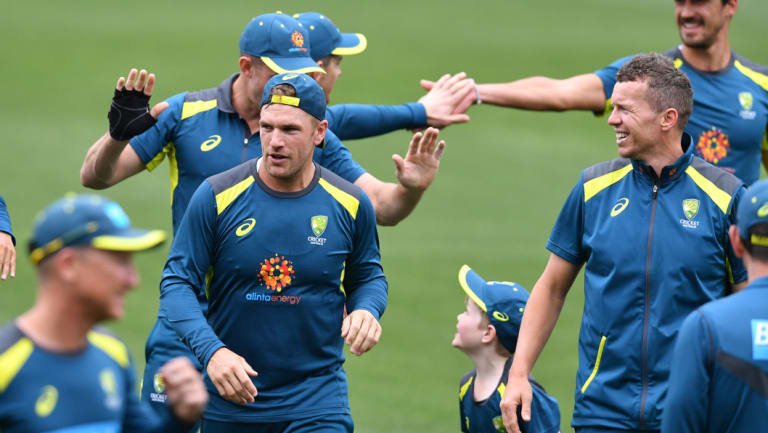 Missing in action: Australia – sans a few key players – train at Adelaide Oval ahead of the first Test.