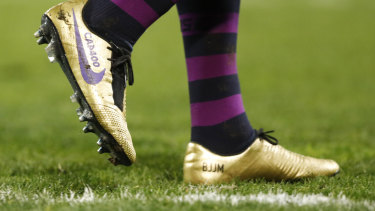 Golden: Cameron Smith wears special boots to mark his milestone match.