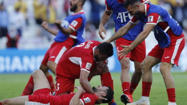 Asian power: Jordan's players celebrate their Asian Cup win over Australia.