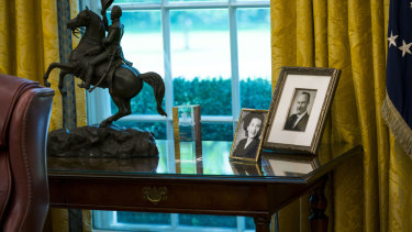 Portraits of President Donald Trump's parents, Mary Anne MacLeod Trump and Fred Trump, in the Oval Office.
