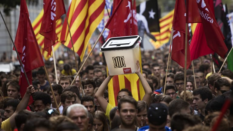 Pro-independence demonstrators march during a protest in Barcelona on Monday.