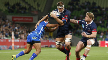 The Rebels' Luke Jones (centre) is tackled in the match against the Stormers.