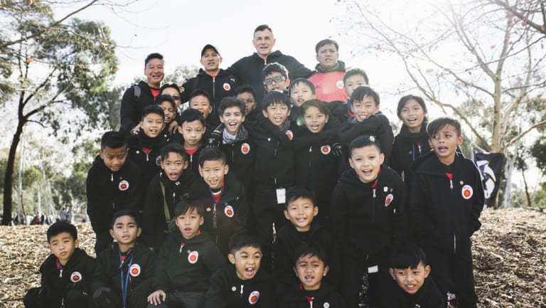Singapore-based ActiveSG Football Academy at the Kanga Cup opening ceremony on Sunday. They are led by former Singapore international footballer Aleksandar Duric (back center).