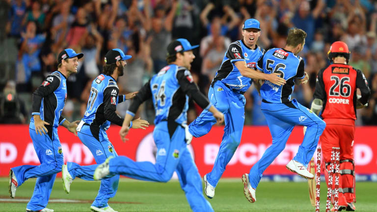 Strikers players celebrates the win after the Big Bash League cricket match semi-final between the Adelaide Strikers and the Melbourne Renegades at Adelaide Oval in Adelaide, Friday, February 2, 2018.