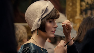 Michelle Dockery has make-up applied during filming on Downton Abbey the film.