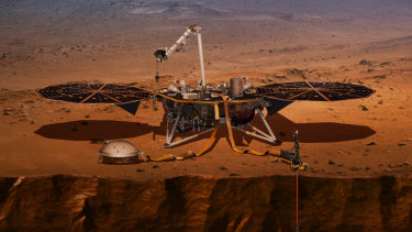 This illustration shows the InSight lander drilling into the surface of Mars.